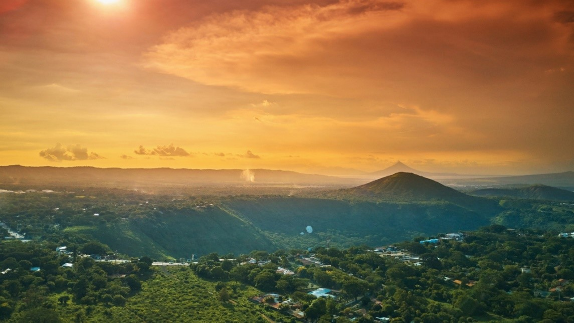 Nicaragua landscape at dawn with a volcano on the background