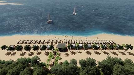 A beautiful beach with white sand. There are boats on the sea