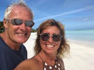 Carla and Simon Fowler on a white sand beach