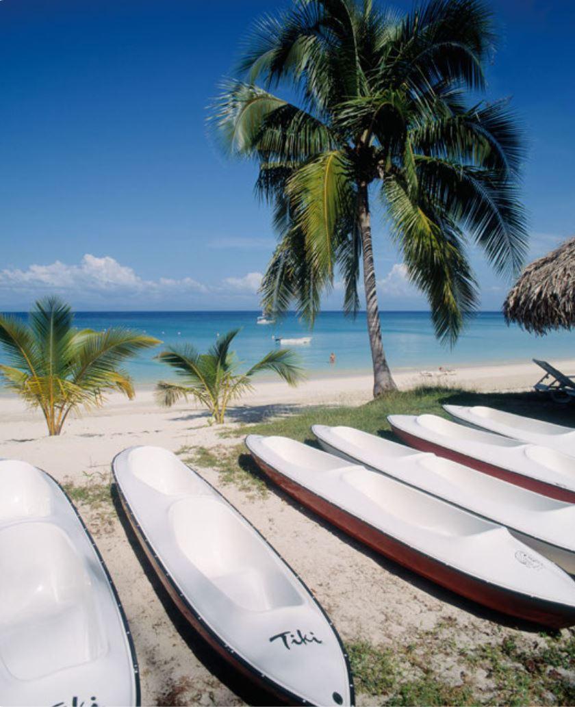 Kayaks on white sand beach