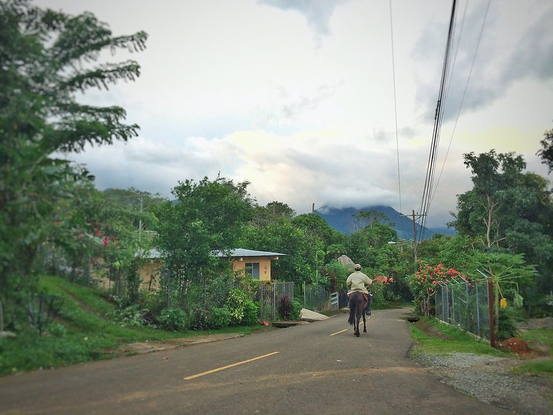 A man on a horse on a street of Santa Fe, Panama